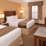 Two queen beds in hotel room at Best Western Executive Inn & Suites